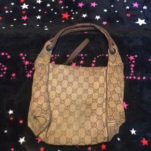 Will trade Gucci bag has little wear tear
